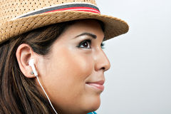 Woman Wearing Earbud Headphones Stock Photography