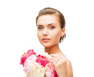Woman wearing earrings and ring with flowers Stock Photography