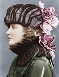 Woman wearing elaborate hat. (All persons depicted are no longer living and no estate exists. Supplier grants that there will be no model release issues Stock Photography