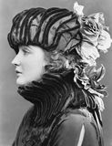 Woman wearing elaborate hat Stock Photography