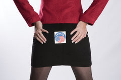Woman wearing an election voted sticker on her backside. Woman with a voting sticky label on her backside stock photos