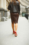 Woman wearing elegant skirt and red high heel shoes in old town Royalty Free Stock Image