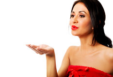 Woman wearing elf clothes blowing kiss Royalty Free Stock Photo
