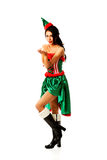 Woman wearing elf clothes blowing kiss Stock Image