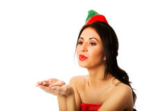 Woman wearing elf clothes blowing kiss Royalty Free Stock Photos