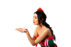 Woman wearing elf clothes blowing kiss Stock Photos