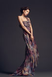 Woman wearing evening dress Stock Images