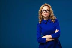 Woman wearing eyeglasses and blue dress Royalty Free Stock Image
