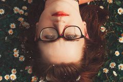 Woman Wearing Eyeglasses Lying On Grass Royalty Free Stock Photo