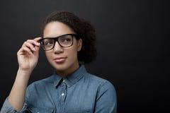 Woman wearing eyewear glasses. Isolated on black background Royalty Free Stock Image
