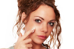 Woman is wearing a face cream.  Royalty Free Stock Photo