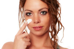 Woman is wearing a face cream.  Royalty Free Stock Image