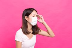 Woman wearing face mask and feeling unwell. Asian young woman Royalty Free Stock Photography