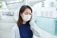 Woman wearing face mask for protection Stock Photo
