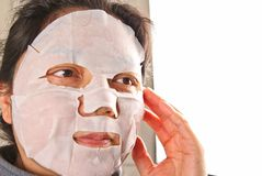 Woman wearing a facemask Royalty Free Stock Images