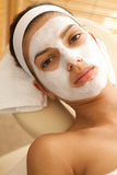 Woman wearing facial mask Royalty Free Stock Photography