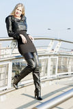 Woman wearing fashionable black boots Stock Photography