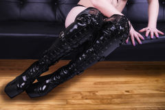 Woman wearing fashionable black boots Stock Images