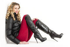 Woman wearing fashionable black boots Royalty Free Stock Photos
