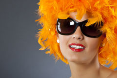 Woman wearing  feather wig Royalty Free Stock Images