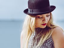 Woman wearing fedora and jumper outdoor Royalty Free Stock Photo