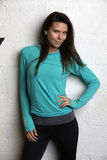 Woman Wearing Fitness Clothing Standing Against Wall Of Gym Royalty Free Stock Image