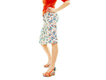 Woman wearing floral skirt and striped sandals Stock Photo