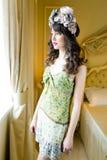 Woman wearing floral wreath on had. Beautiful young woman wearing floral wreath on had Stock Images