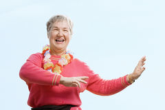 Woman wearing flower garland and dancing Stock Photography