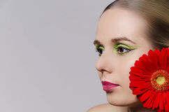 Woman wearing a flower in her hair horizontal Royalty Free Stock Photography
