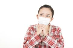 Woman got a cold. Woman wearing a flu mask stock photography