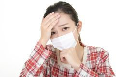 Woman got a cold. Woman wearing a flu mask royalty free stock images