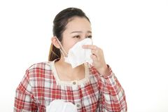Woman got a cold. Woman wearing a flu mask stock photo
