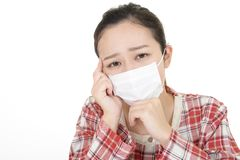 Woman got a cold. Woman wearing a flu mask stock image