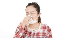 Woman got a cold. Woman wearing a flu mask royalty free stock photo