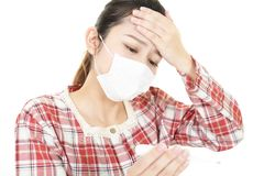 Woman got a cold. Woman wearing a flu mask royalty free stock photos