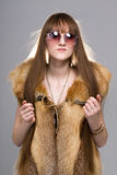 Woman wearing a fox fur Stock Photo