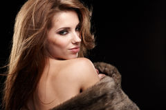 Woman wearing fur Royalty Free Stock Image