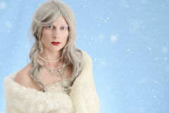 Woman wearing fur cloak with snow Royalty Free Stock Photography