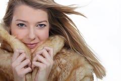 Woman wearing a fur coat. Woman wearing a comfortable fur coat Royalty Free Stock Photo