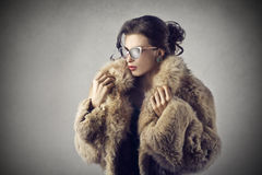 Woman wearing a fur coat Stock Photography