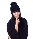 Woman wearing a fur coat and a hat Stock Images