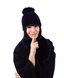 Woman wearing a fur coat and a hat Royalty Free Stock Photography