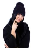 Woman wearing a fur coat and a hat Stock Photography