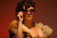 Woman wearing fur and glasses Stock Image