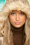 Woman wearing fur hood Stock Images