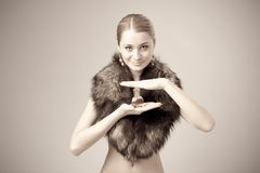 Woman wearing fur with perfume Royalty Free Stock Photography