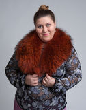 Woman wearing fur scarf Stock Photos