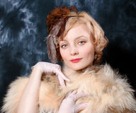 woman wearing  fur and silk adornment Stock Image