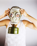 Woman wearing gas mask Stock Photo